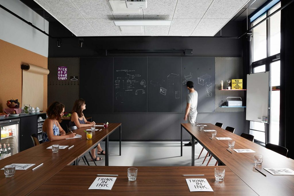 Classroom with hotties seated at u-shape set-up at The Student H