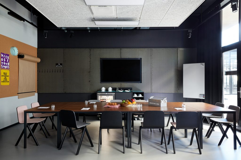 Empty boardroom with conference table at The Student Hotel Amste